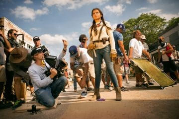 Left to right: Director/Executive Producer Michael Bay and Isabela Moner on the set of TRANSFORMERS: THE LAST KNIGHT, from Paramount Pictures.